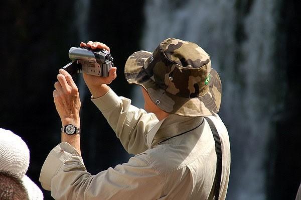 Turista filmando